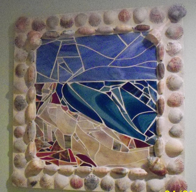 Glass mosaic surrounded by seashells