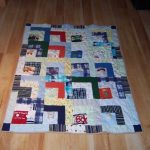 Quilt created using pieces of clients' sons clothing